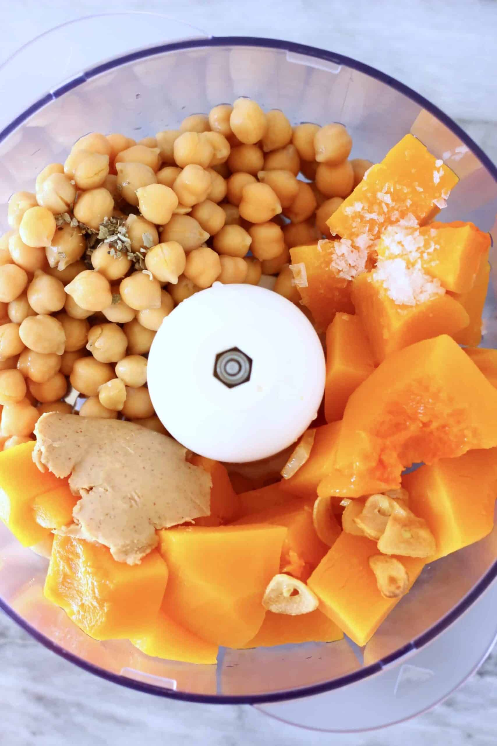 Chickpeas, dried sage, cooked pumpkin pieces, tahini and fried garlic in a food processor