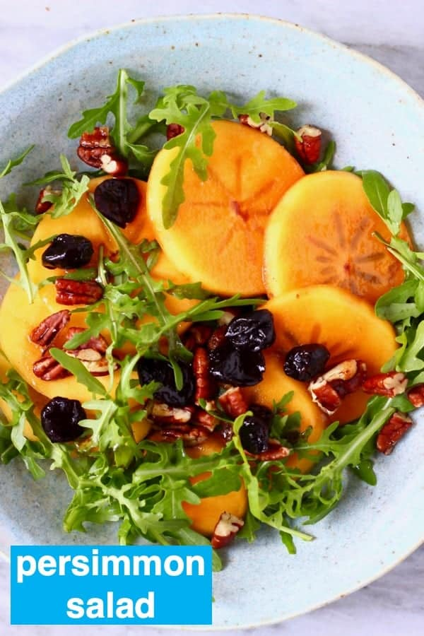This Persimmon Salad is supereasyto make,sweetandfruityand beautifullycolourful. A great sidedish for autumn/winter, Thanksgiving or Christmas. Vegan, vegetarian, dairy-free, gluten-free. #vegan #sidedish #persimmon #salad #christmas #thanksgiving #rhiansrecipes