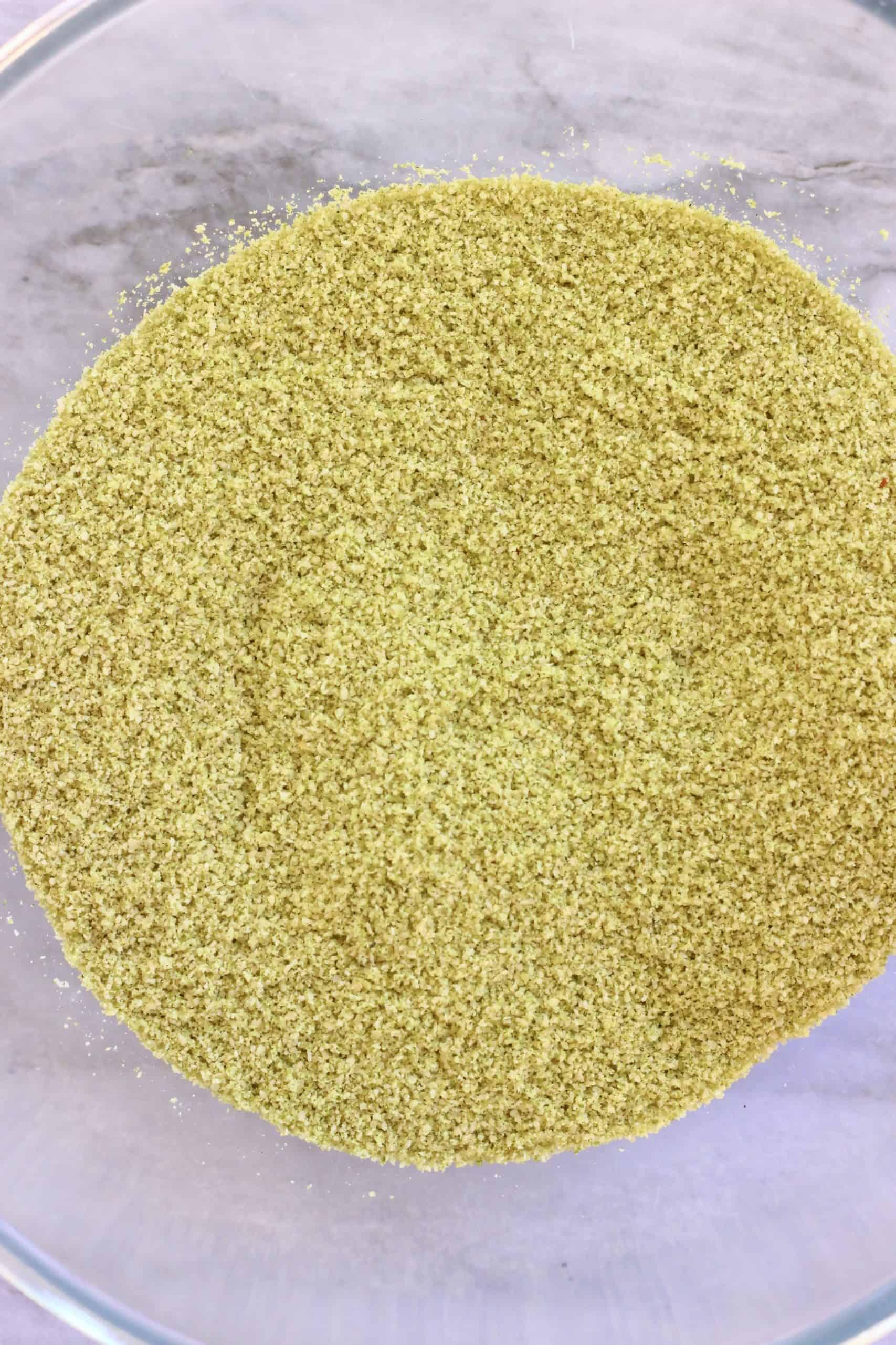 Ground almonds, brown rice flour, salt and matcha powder in a mixing bowl