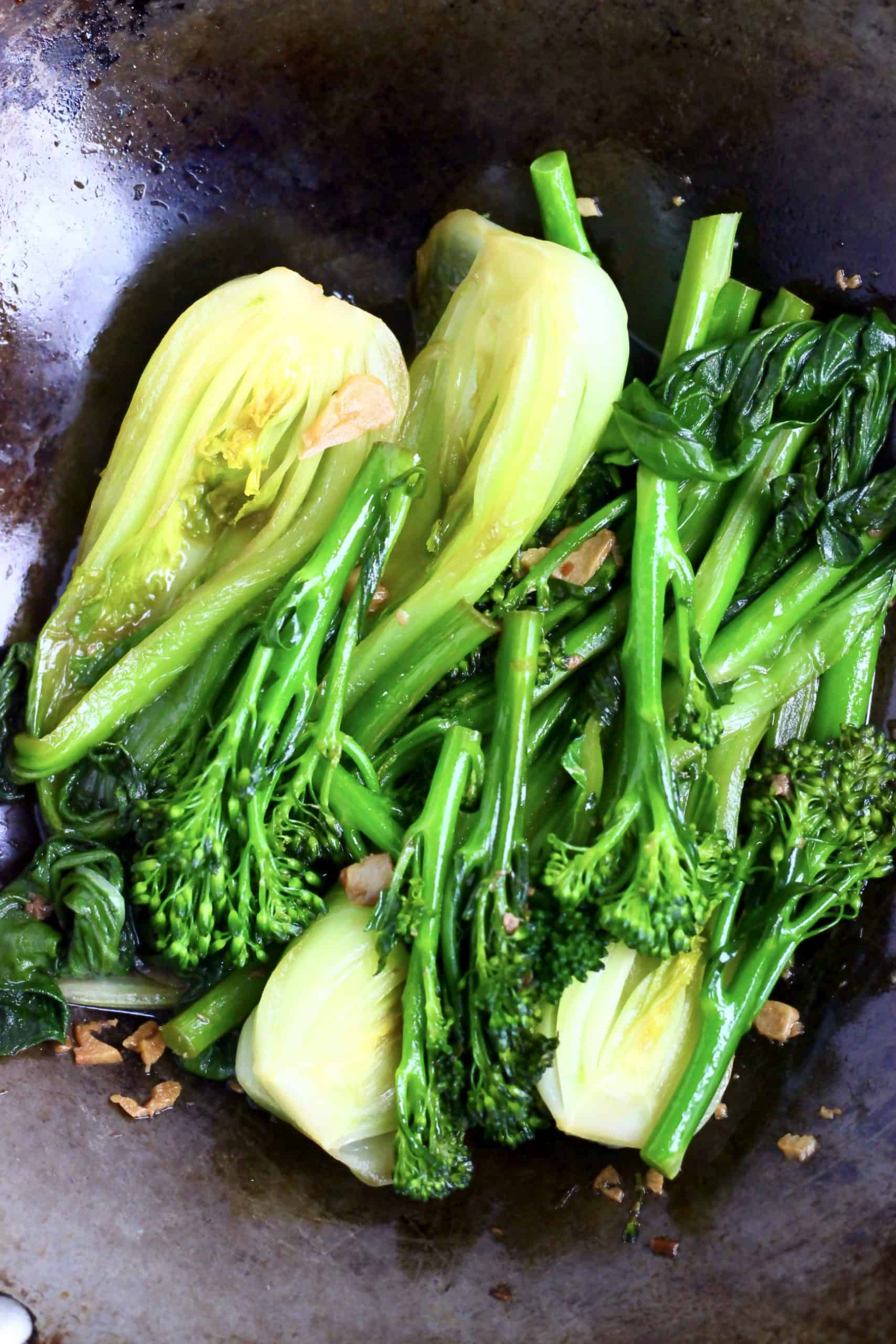 Cooked Wagamama wok-fried greens in a black wok