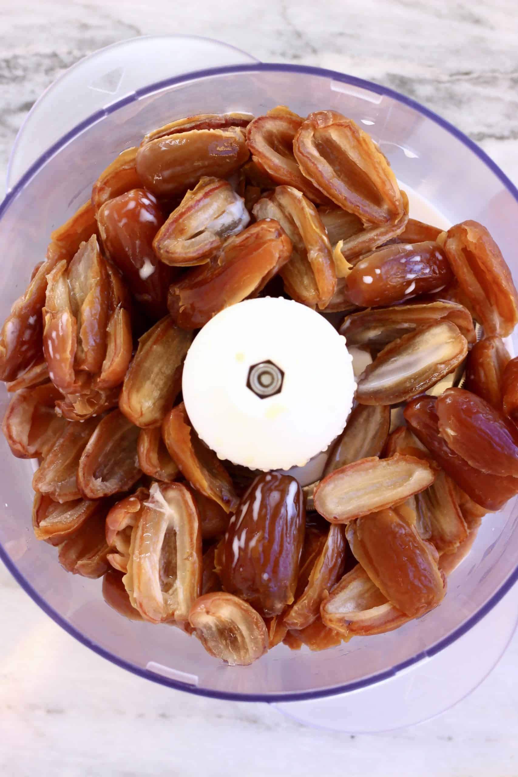 Dates and almond milk in a food processor