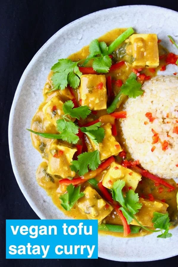 This Peanut Tofu Satay Curry is amazingly easy to make, super satisfying, and packed full of flavour. A super easy 20-minute weeknight dinner recipe. Vegan, vegetarian, dairy-free and gluten-free. #rhiansrecipes #tofu #curry #vegan #vegetarian #dairyfree #glutenfree