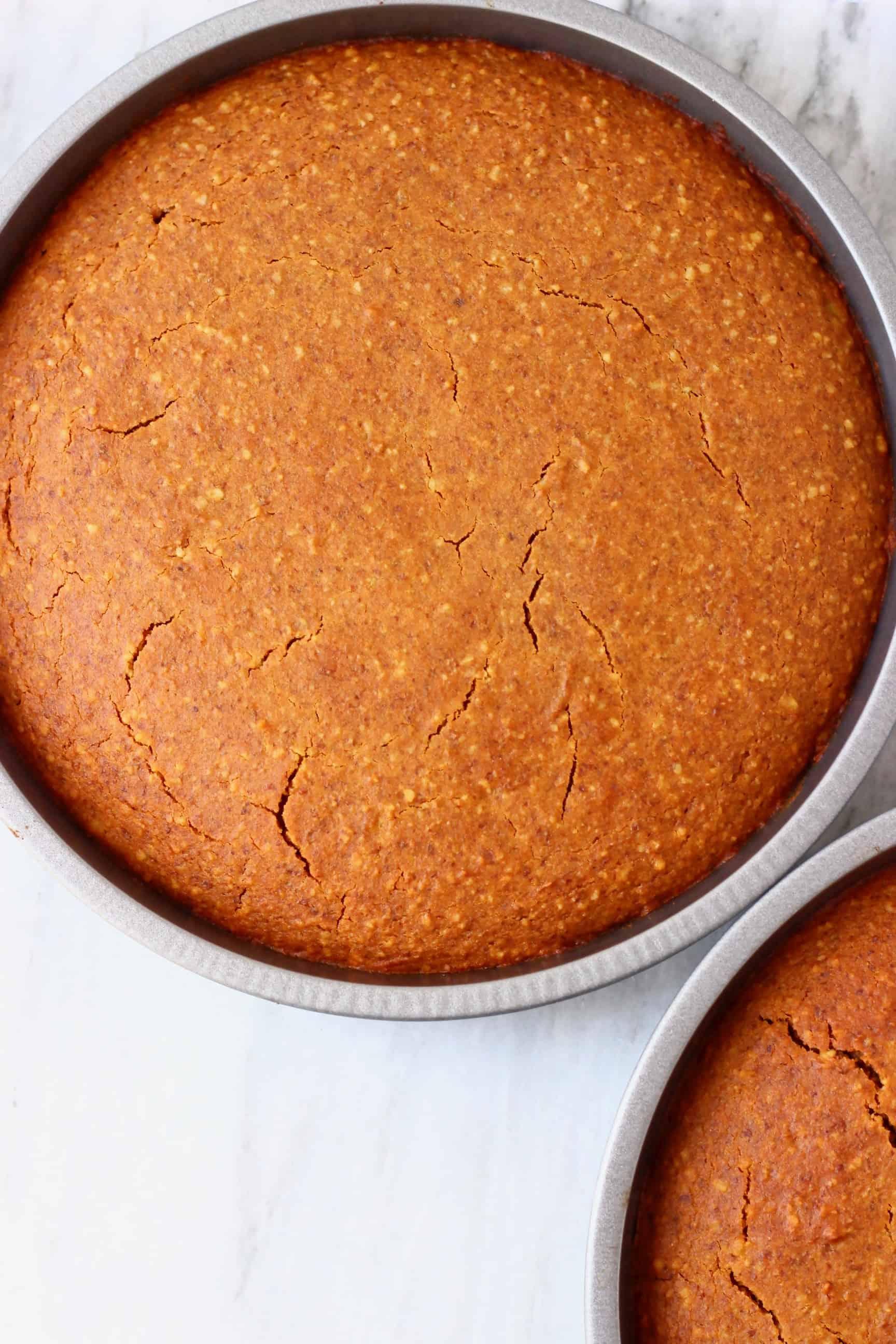 Gluten-free vegan coffee cake sponges in two round baking tins