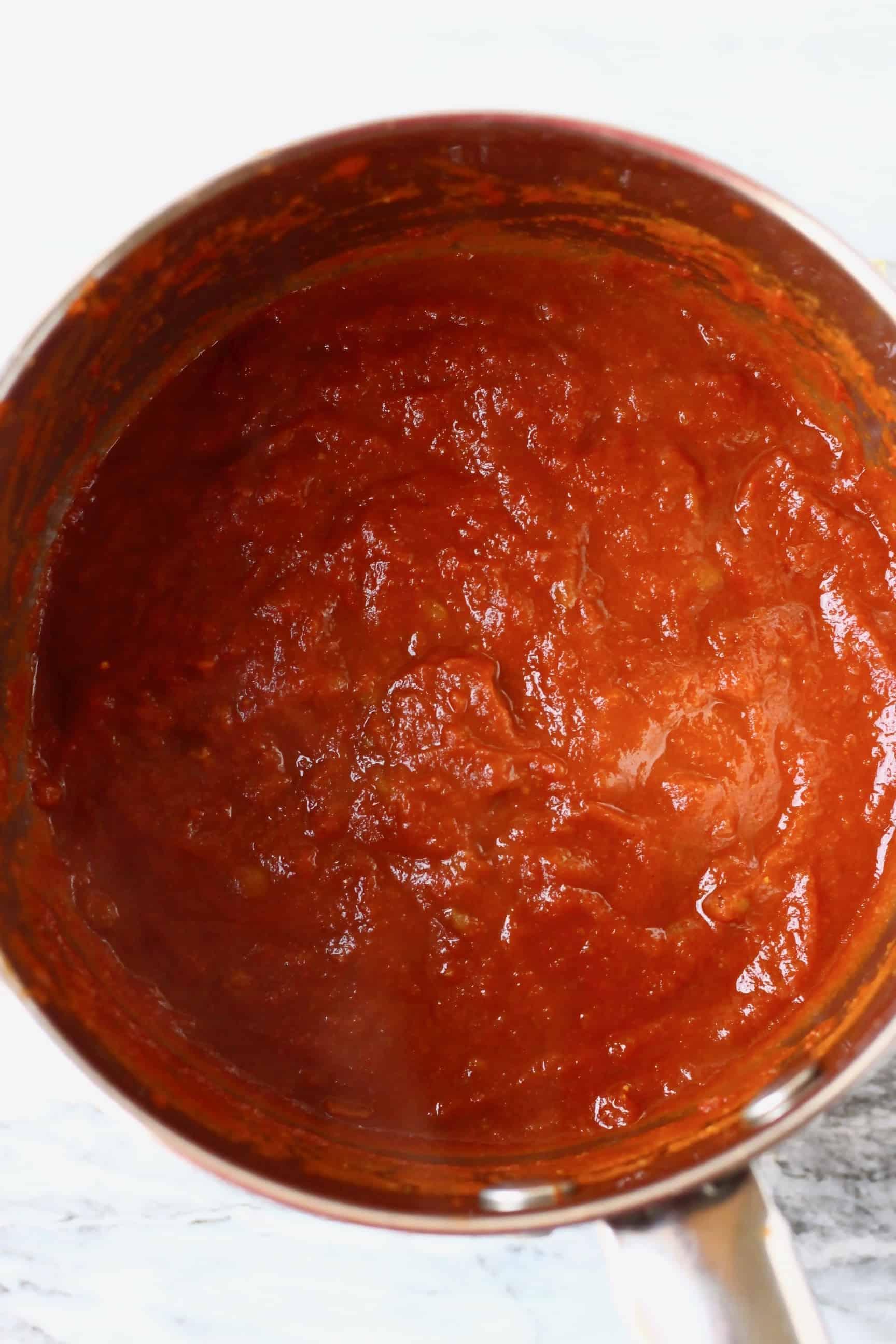 Blended vegan BBQ sauce in a silver saucepan