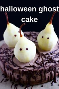 Photo of a chocolate cake topped with three pears made to look like ghosts