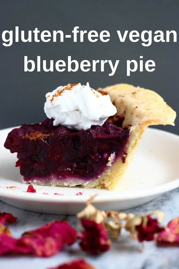 This Gluten-Free Vegan Blueberry Pie has a crispy, flaky, buttery pastry crust and is filled with sweet, juicy blueberries. The perfect dessert for summer, Fourth of July or Thanksgiving! Egg-free, dairy-free and refined sugar free. #vegan #glutenfree #dairyfree #pie #blueberry #baking #thanksgiving #dessert