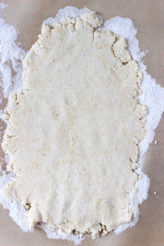 Photo of pastry rolled out on a piece of brown baking paper