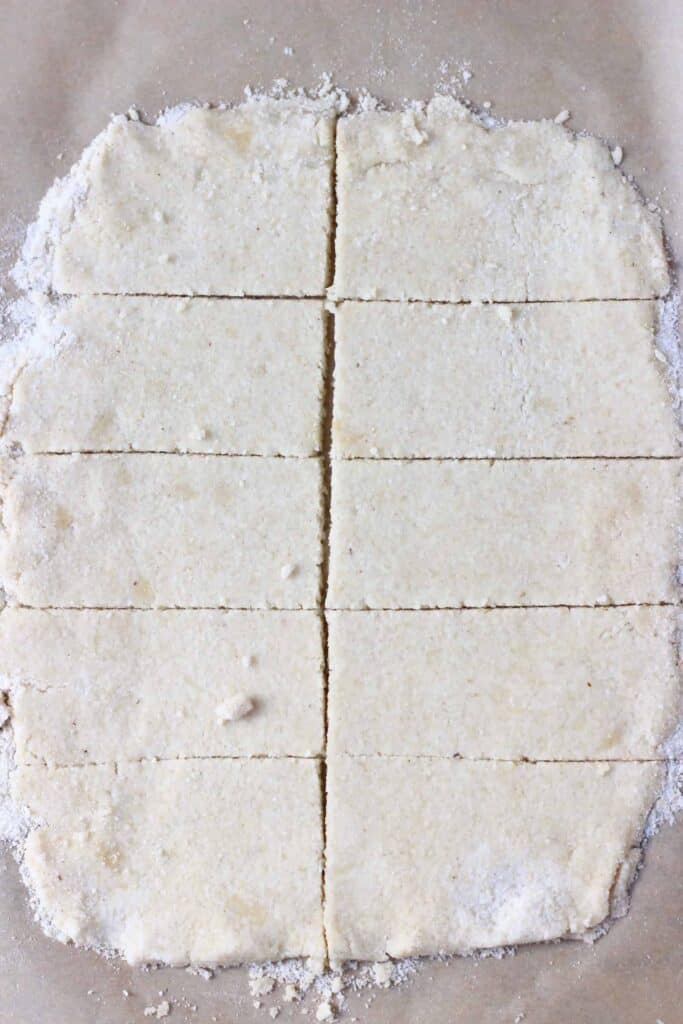 Photo of pastry rolled out and cut into ten pieces on a piece of brown baking paper