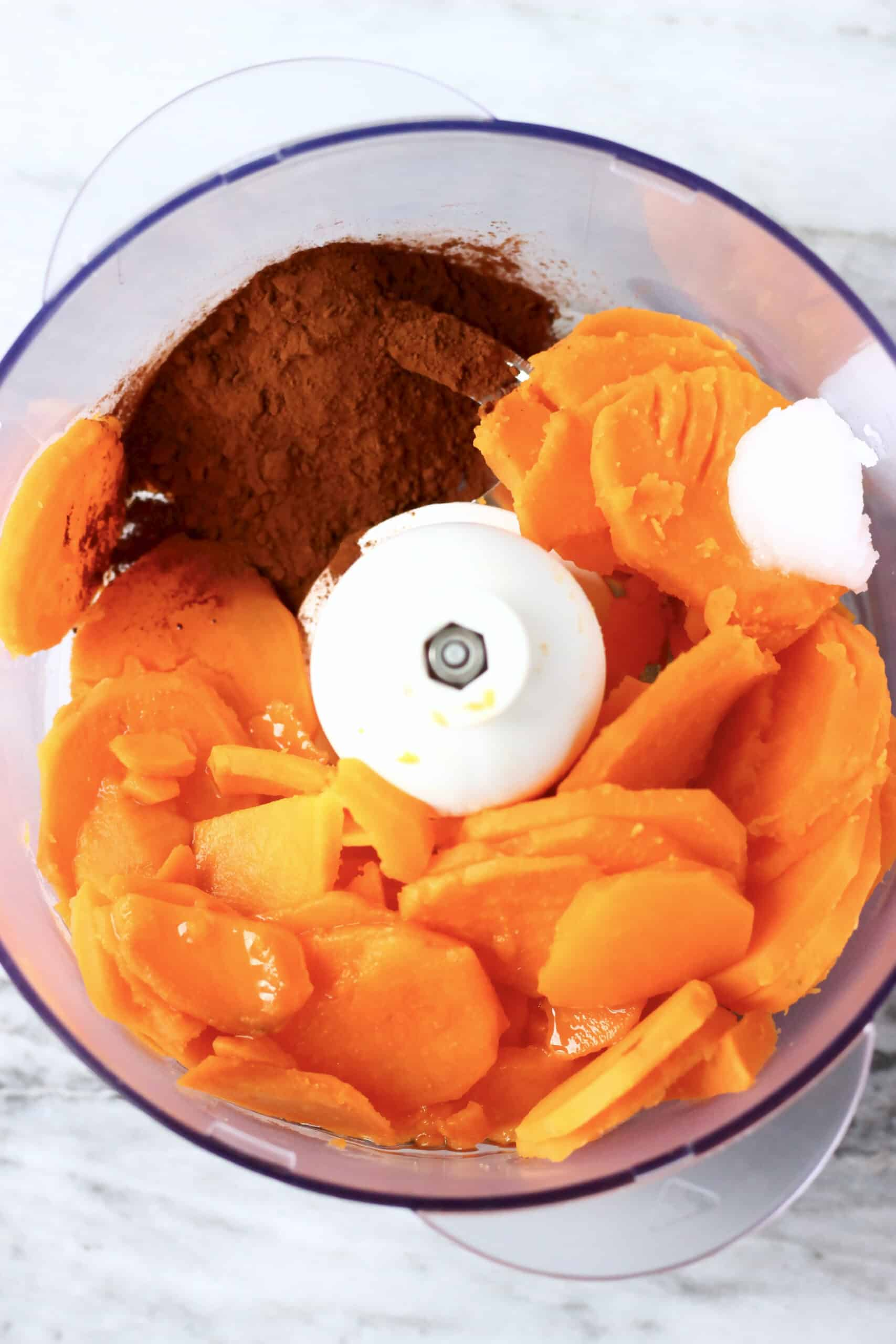 Cooked sweet potato, coconut oil, maple syrup and cocoa powder in a food processor