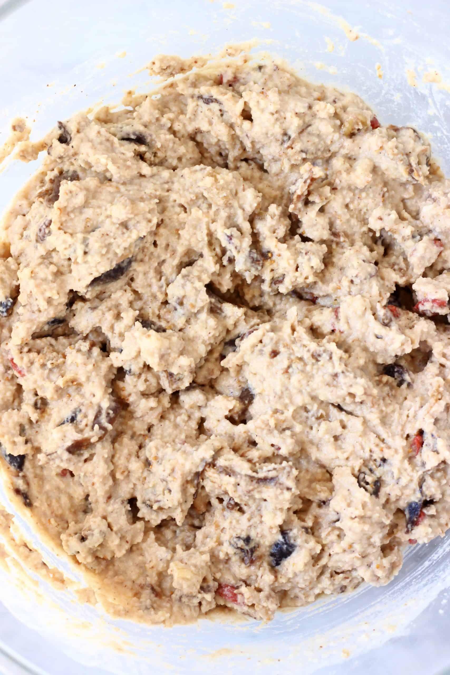 Raw gluten-free vegan fruit cake batter in a bowl