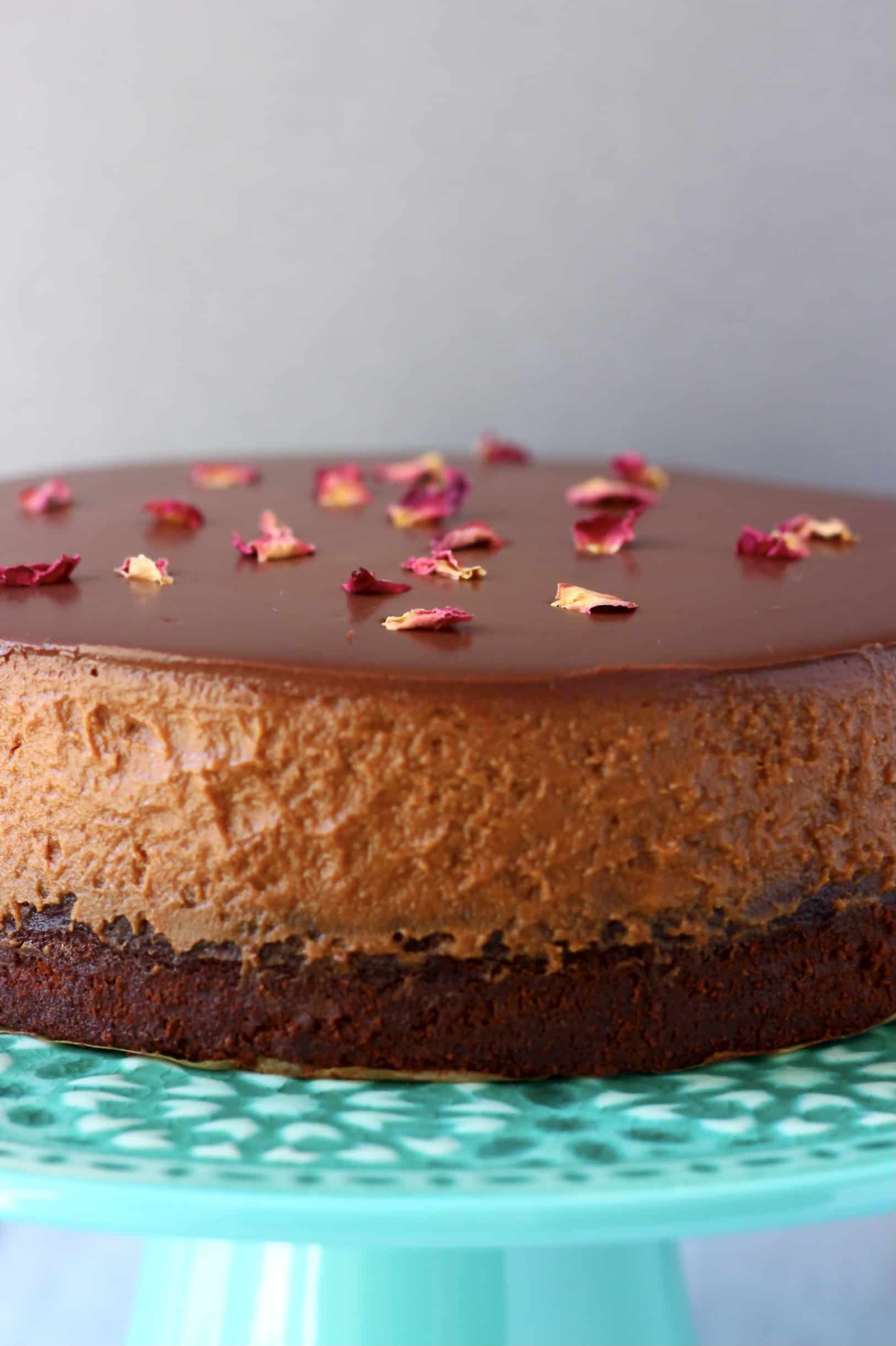 A gluten-free vegan chocolate mousse cake on a cake stand