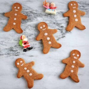 Photo of five gingerbread men on a marble background