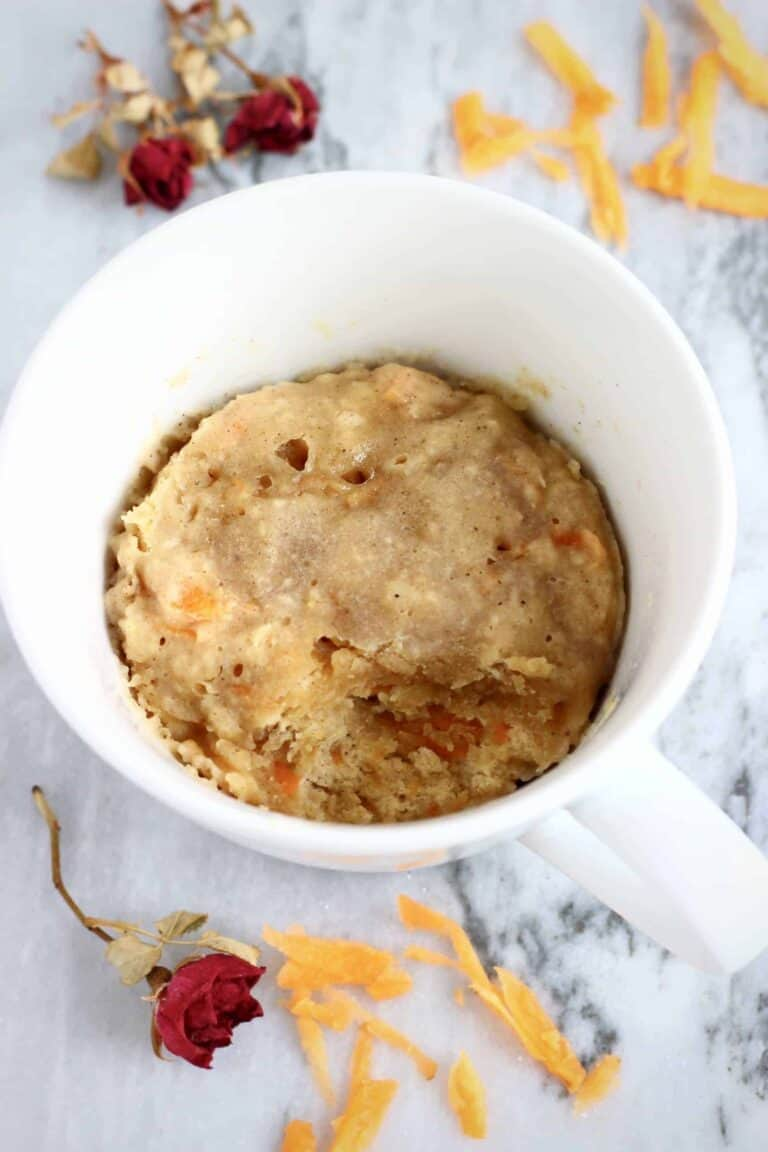 carrot cake mug cake in a white cup