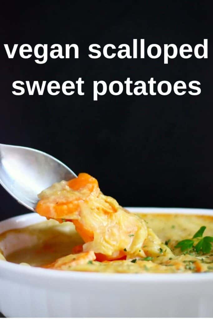 Photo of a sweet potato gratin against a black background with a mouthful being lifted up with a spoon