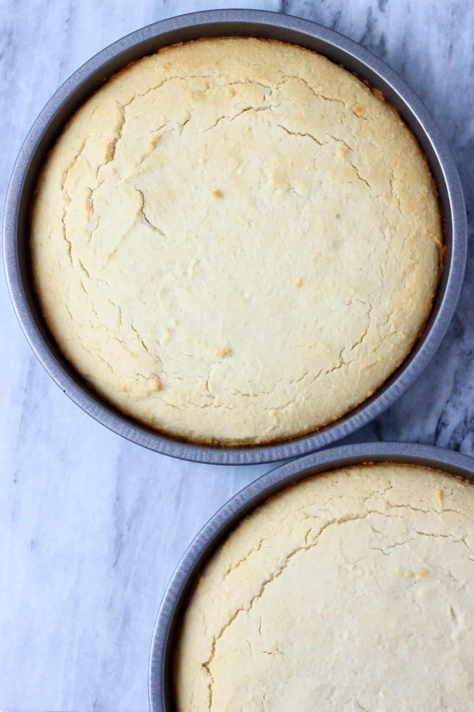 Gluten-free vegan coconut cake sponges in two circular baking tins
