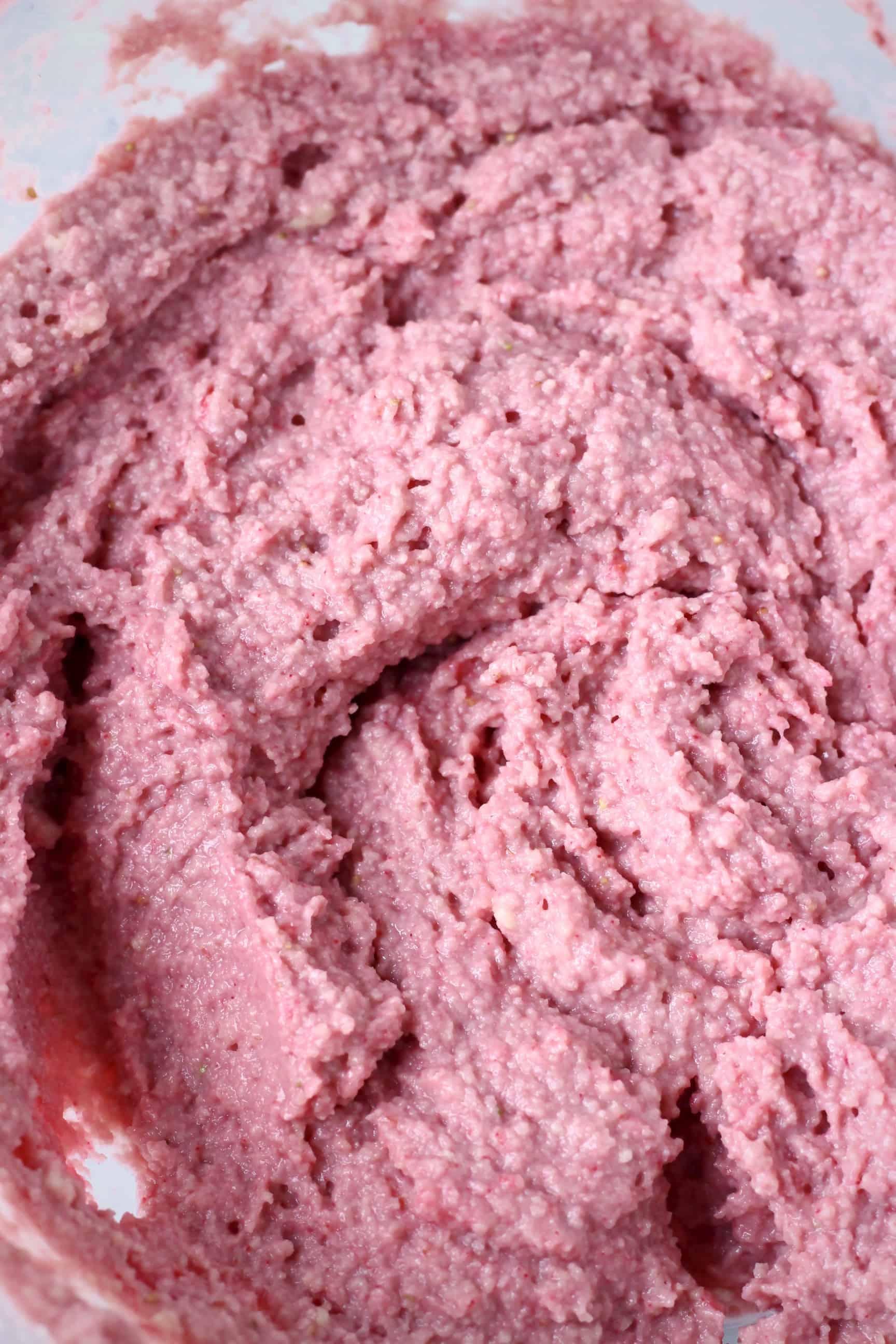 Raw pink gluten-free vegan strawberry cake batter in a bowl