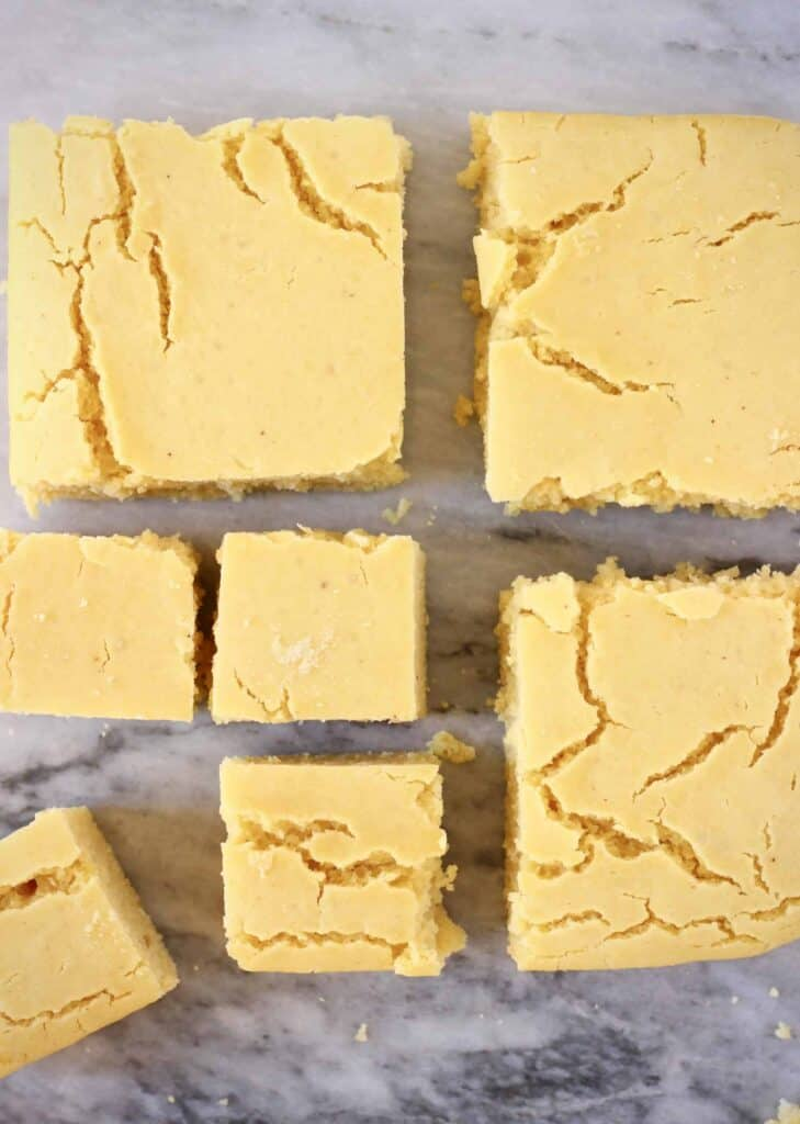 Photo of three large squares of cornbread and four smaller squares on a marble background