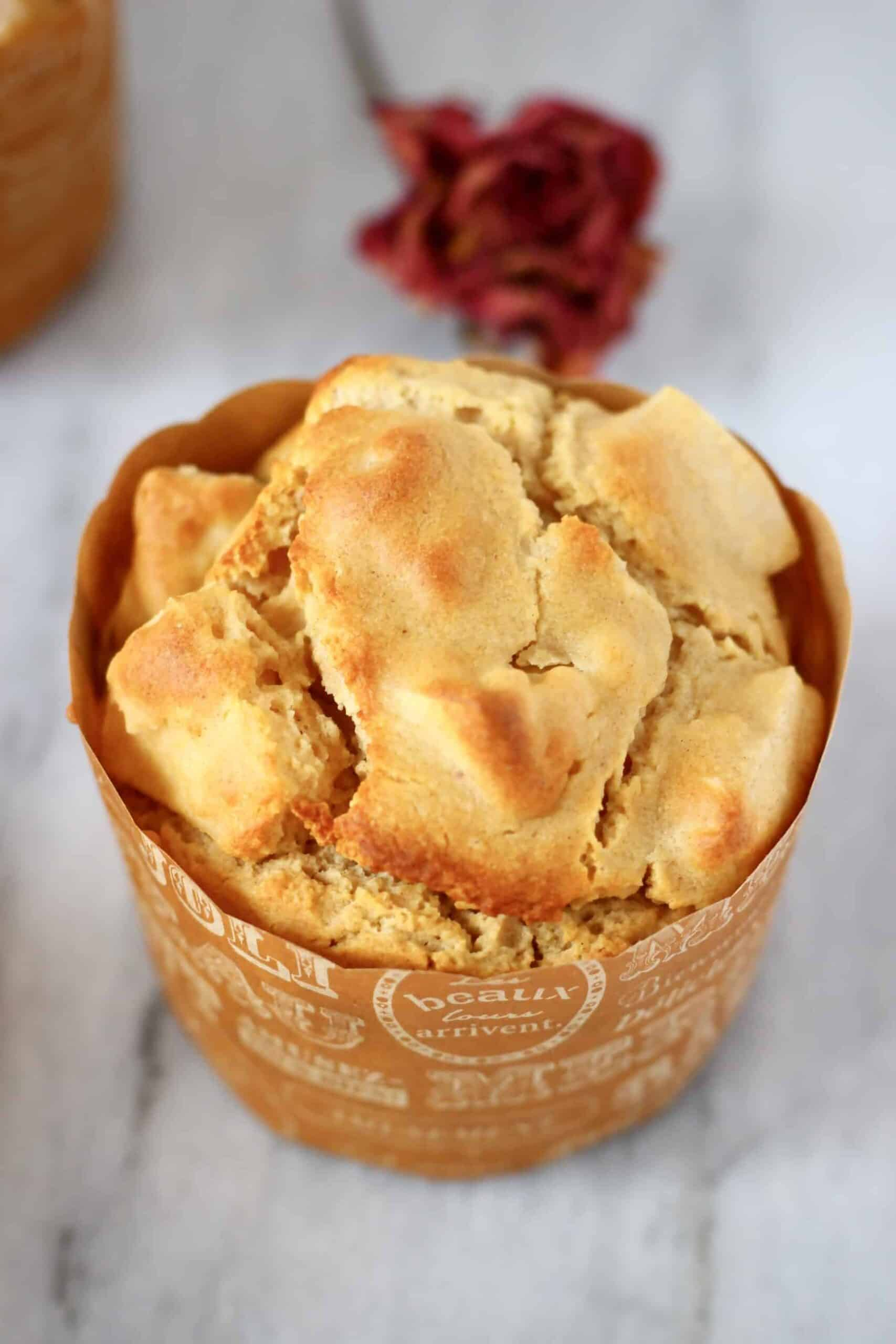 A gluten-free vegan apple muffin in a brown muffin case