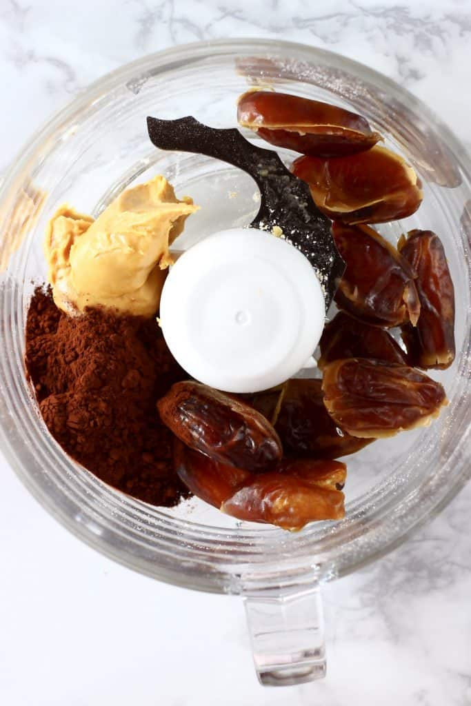 Dates, almond butter, salt and cocoa powder in a food processor