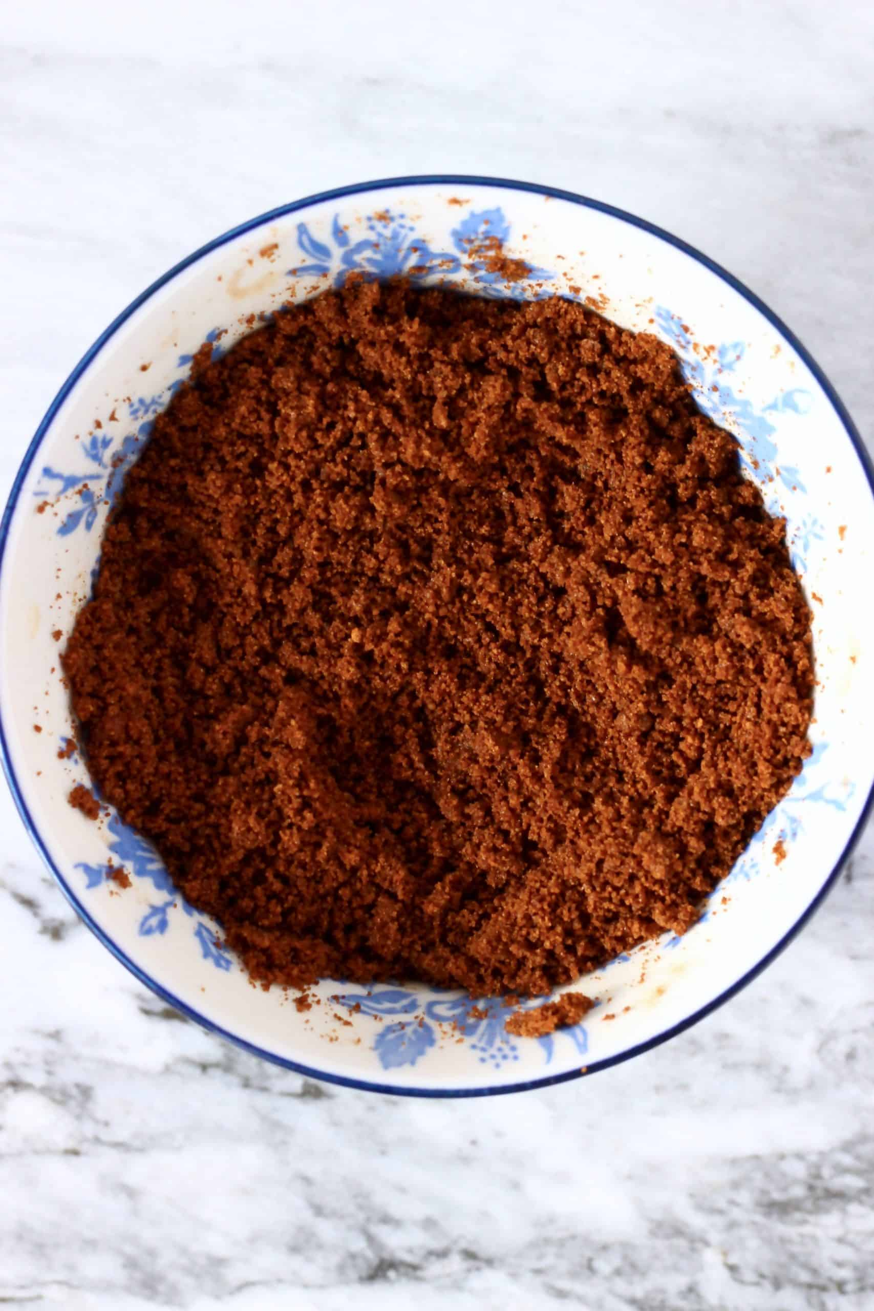 Cinnamon, coconut sugar and coconut oil mixed together in a bowl