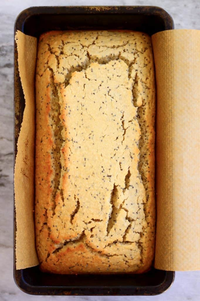Lemon poppy seed cake in a loaf tin lined with baking paper