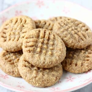 A pile of peanut butter cookies on a white plate