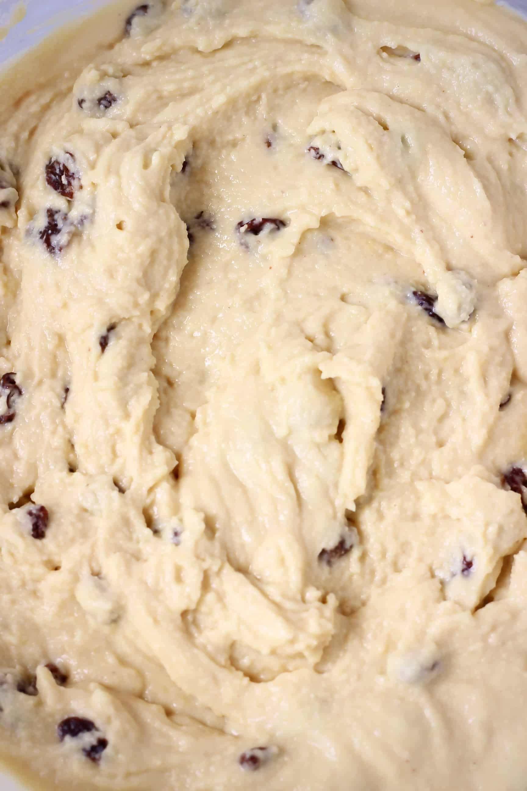Gluten-Free Vegan Irish Soda Bread batter with raisins in a bowl