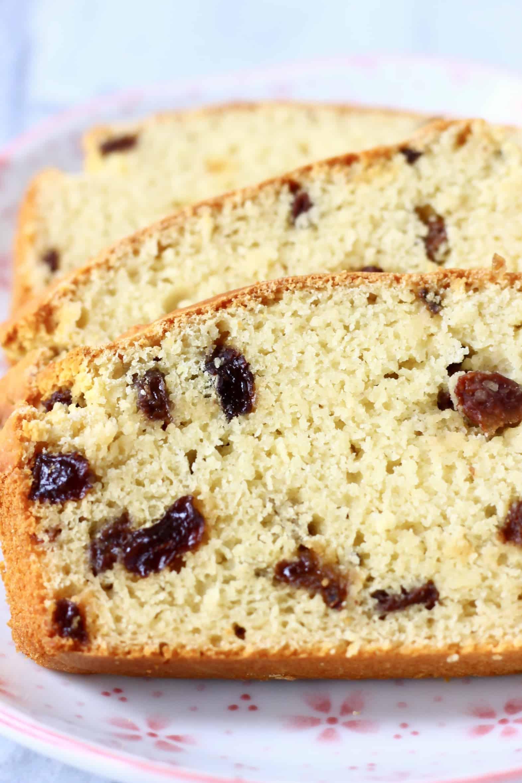 Three slices of Gluten-Free Vegan Irish Soda Bread with raisins on a plate