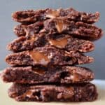 A stack of halved chocolate cookies against a grey background