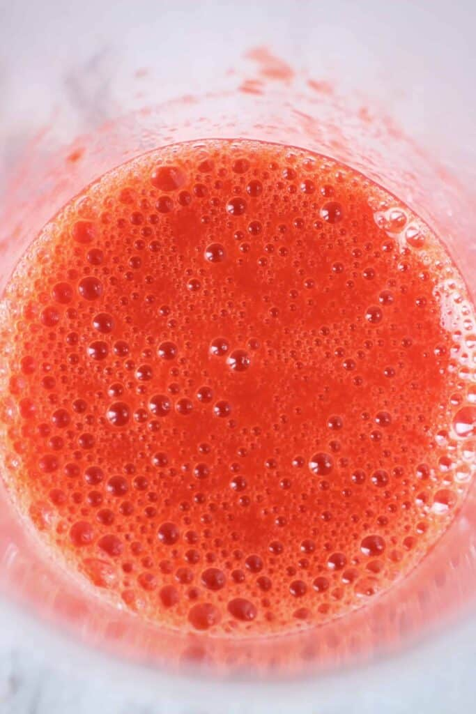 Photo of strawberry purée in a glass