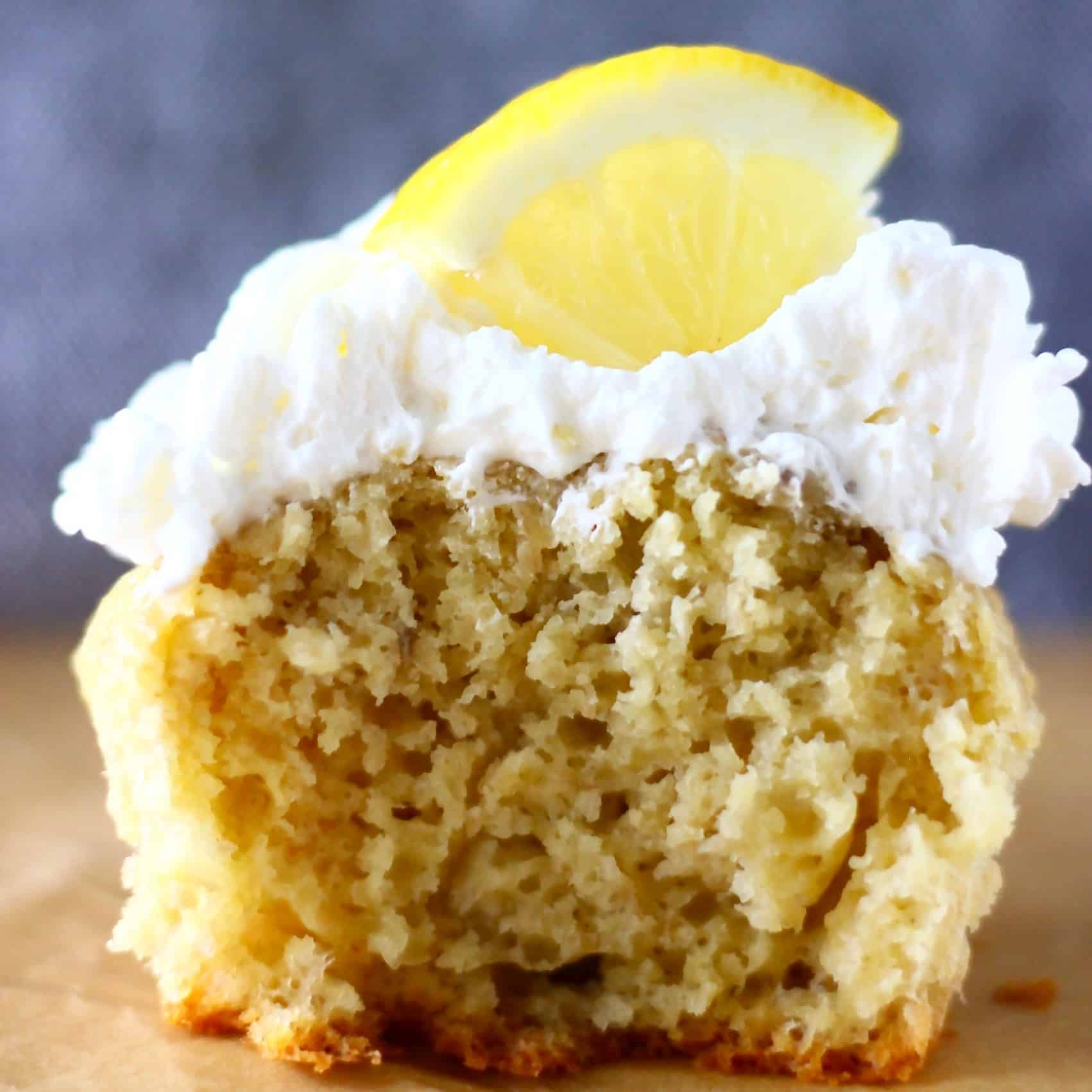 "These Gluten-Free Vegan Lemon Cupcakes are the perfect simple yet elegant dessert: they're sweet and tangy, and smothered in a rich ""cream cheese"" frosting! They're also egg-free, refined sugar free and nut-free optional. #vegan #glutenfree #dairyfree #lemon #cupcakes #dessert #baking"