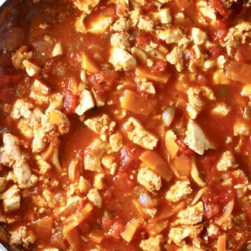 Photo of tofu crumbles and vegetables in a red tomato sauce