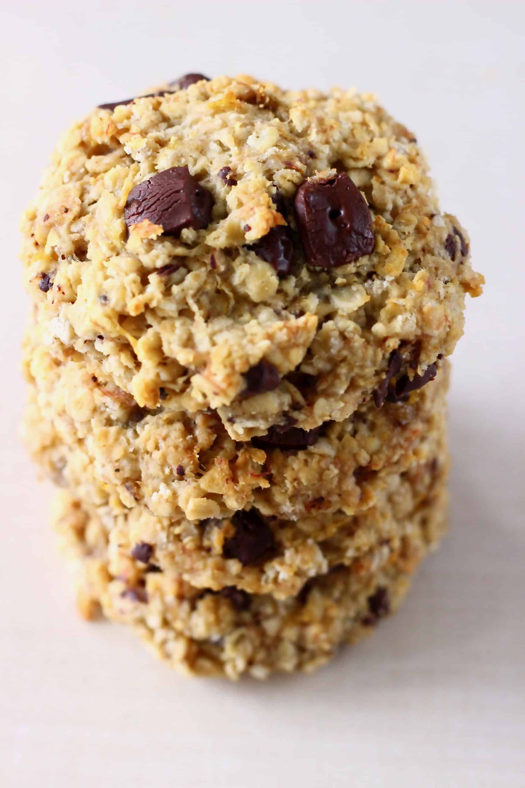 A stack of four gluten-free vegan banana oatmeal cookies with chocolate chips
