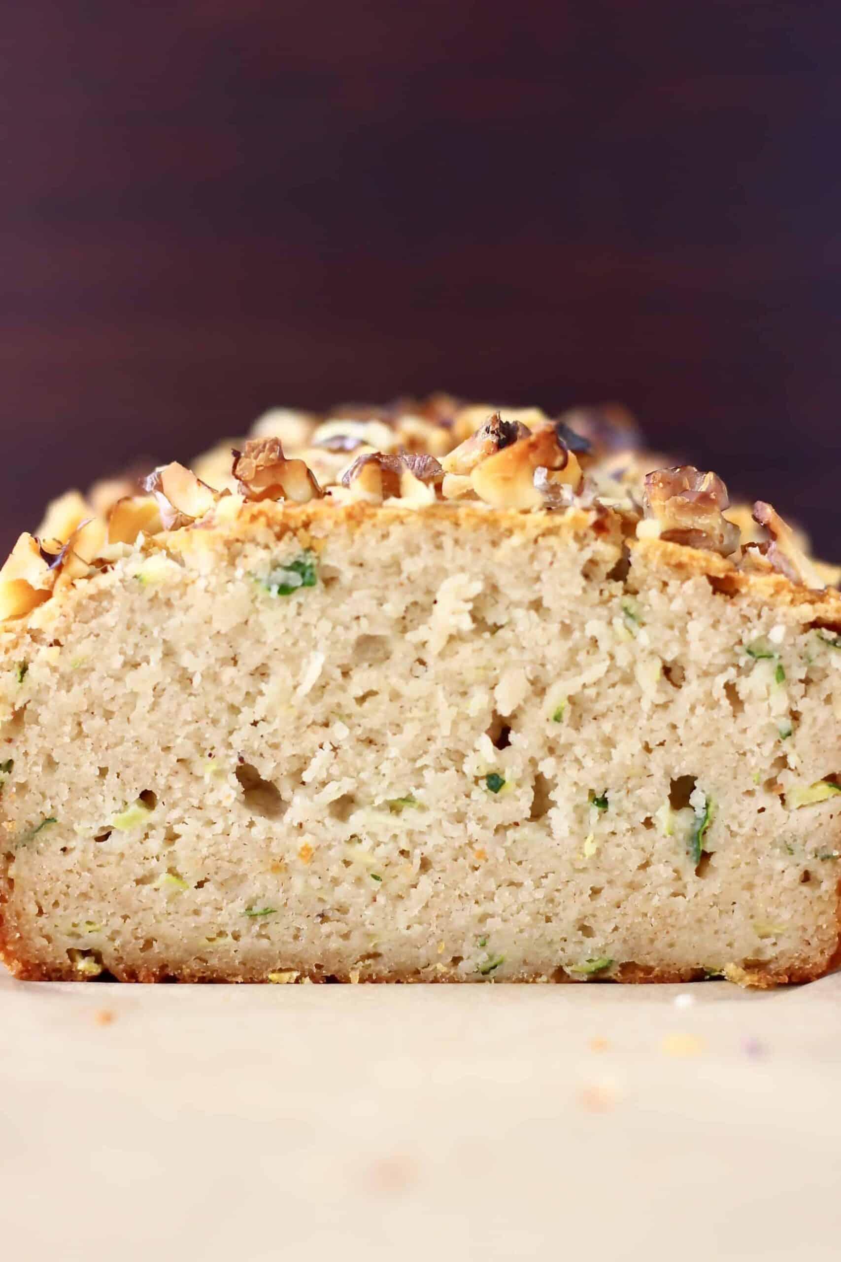 A sliced loaf of gluten-free vegan zucchini bread