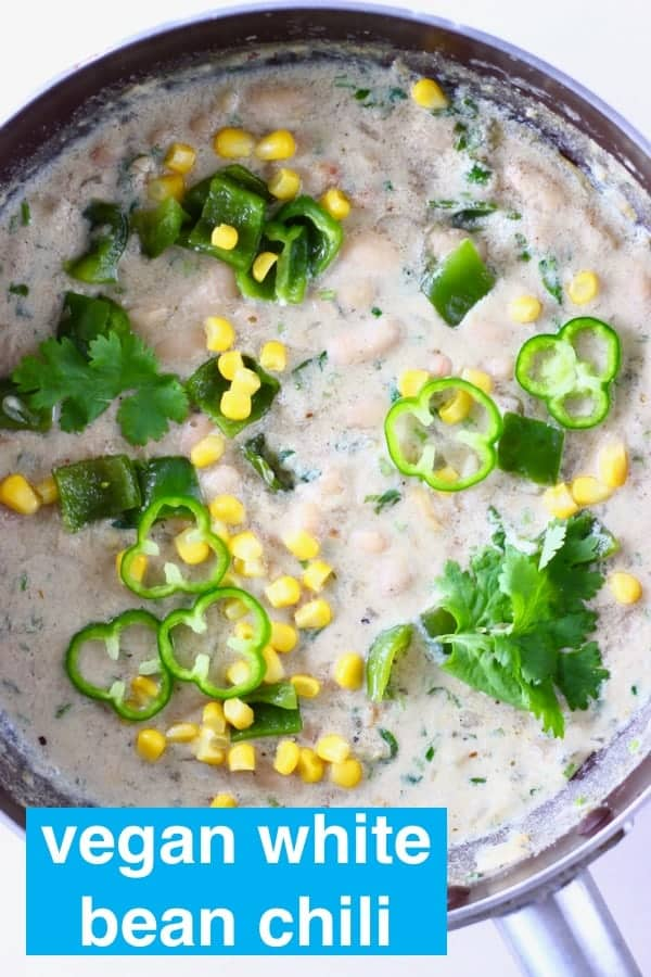 Photo of a saucepan with white stew with white beans, sweetcorn and green pepper
