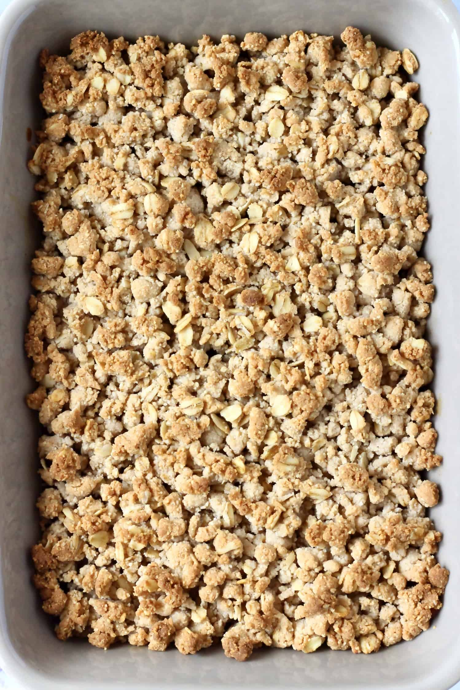 Golden brown gluten-free vegan apple crumble in a rectangular baking dish
