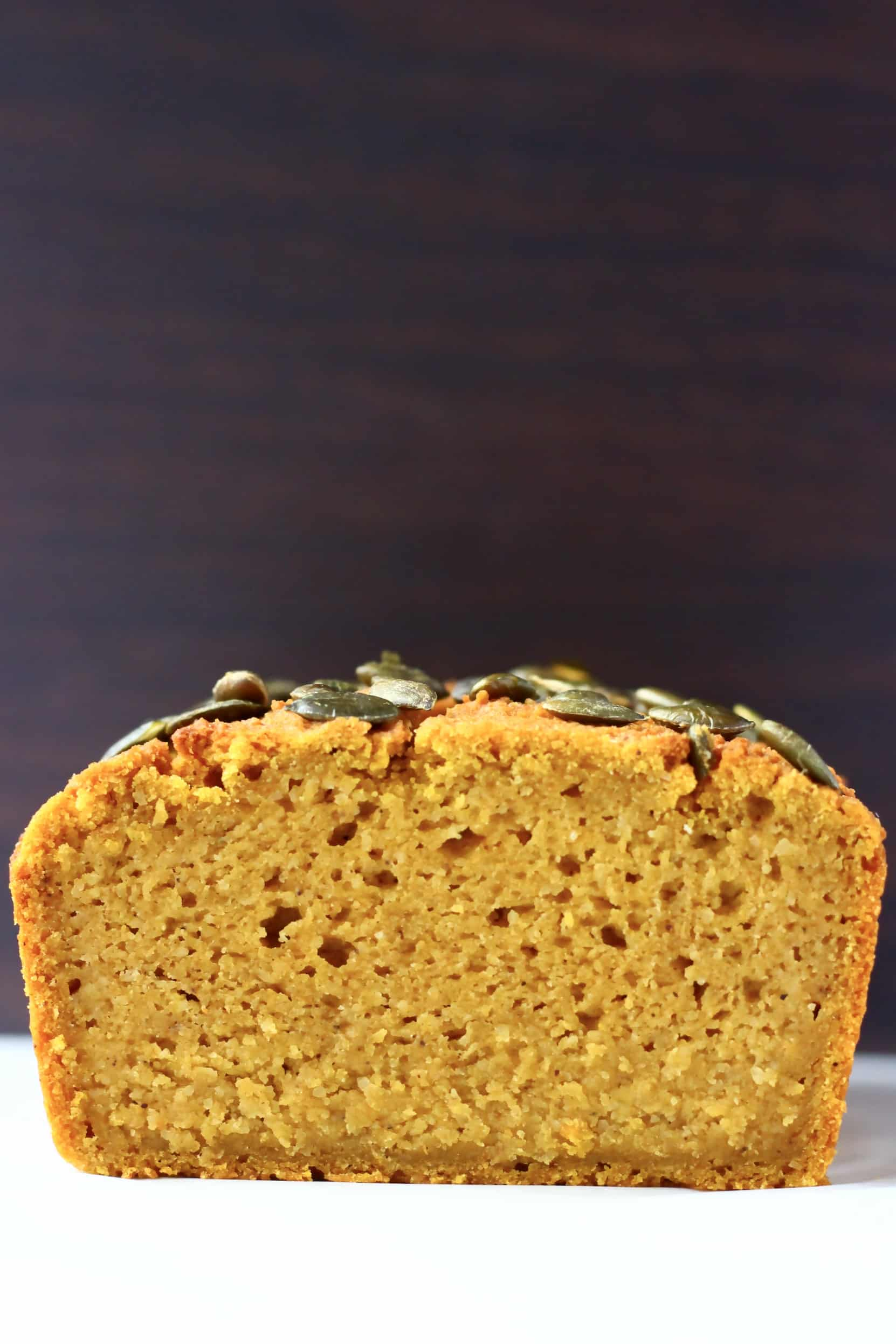 A sliced loaf of gluten-free vegan pumpkin bread