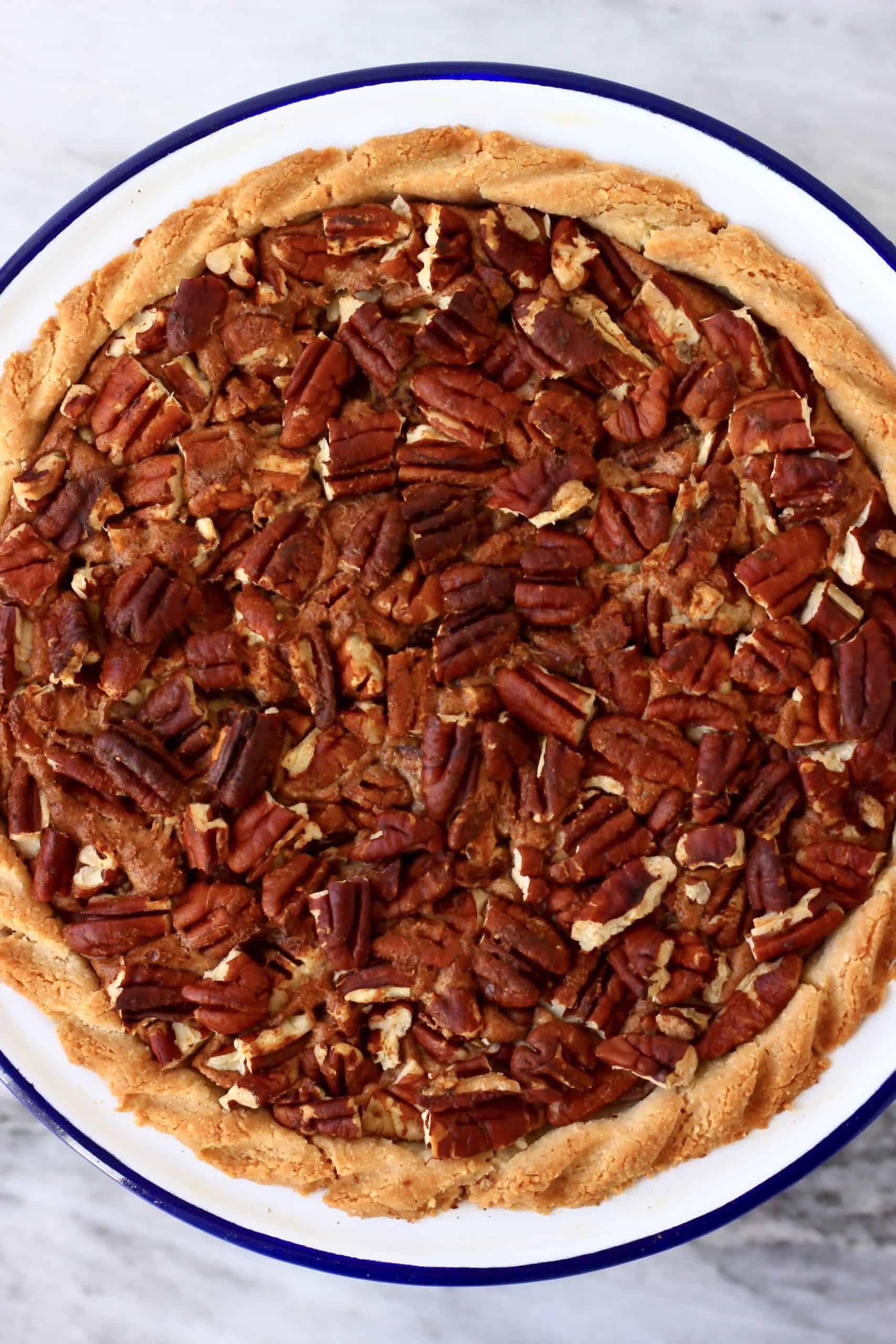 A gluten-free vegan pecan pie in a pie dish