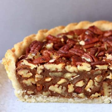 A sliced gluten-free vegan pecan pie on a plate