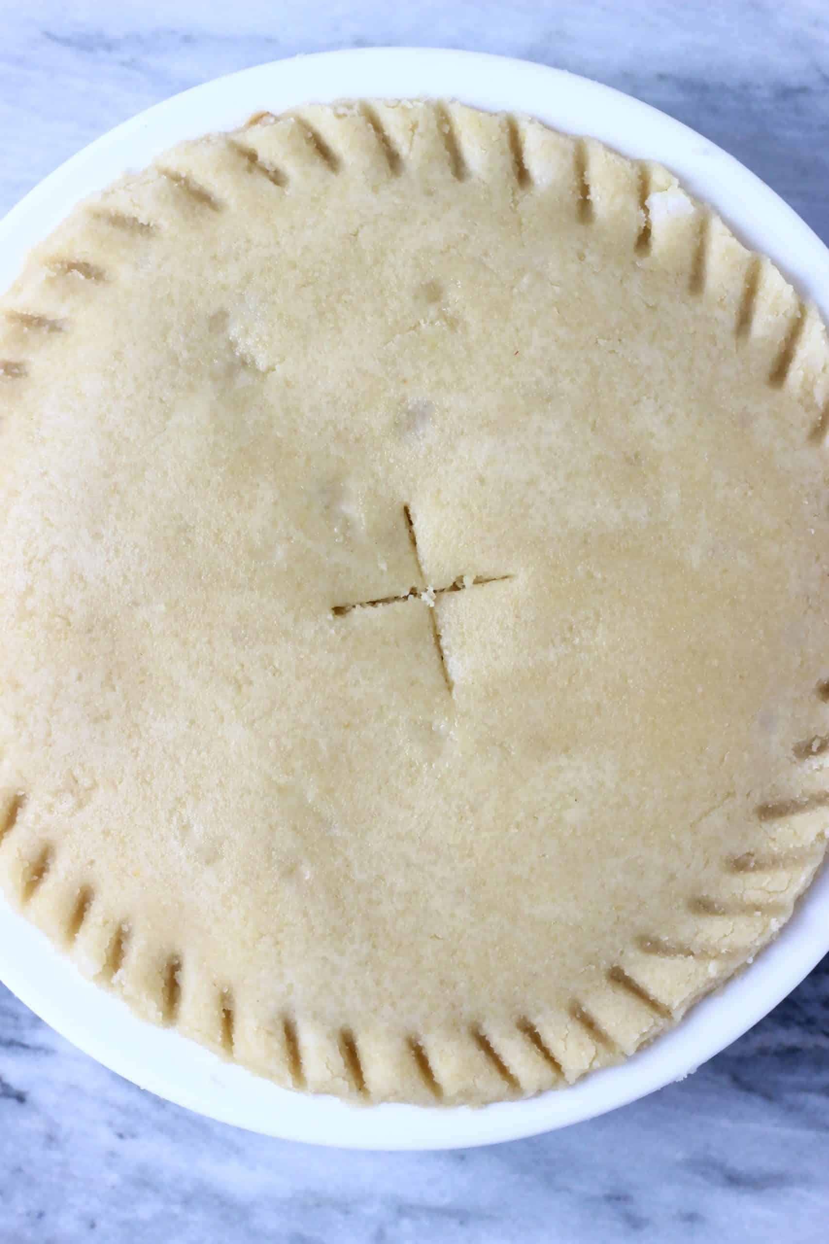 A raw gluten-free vegan apple pie in a pie dish