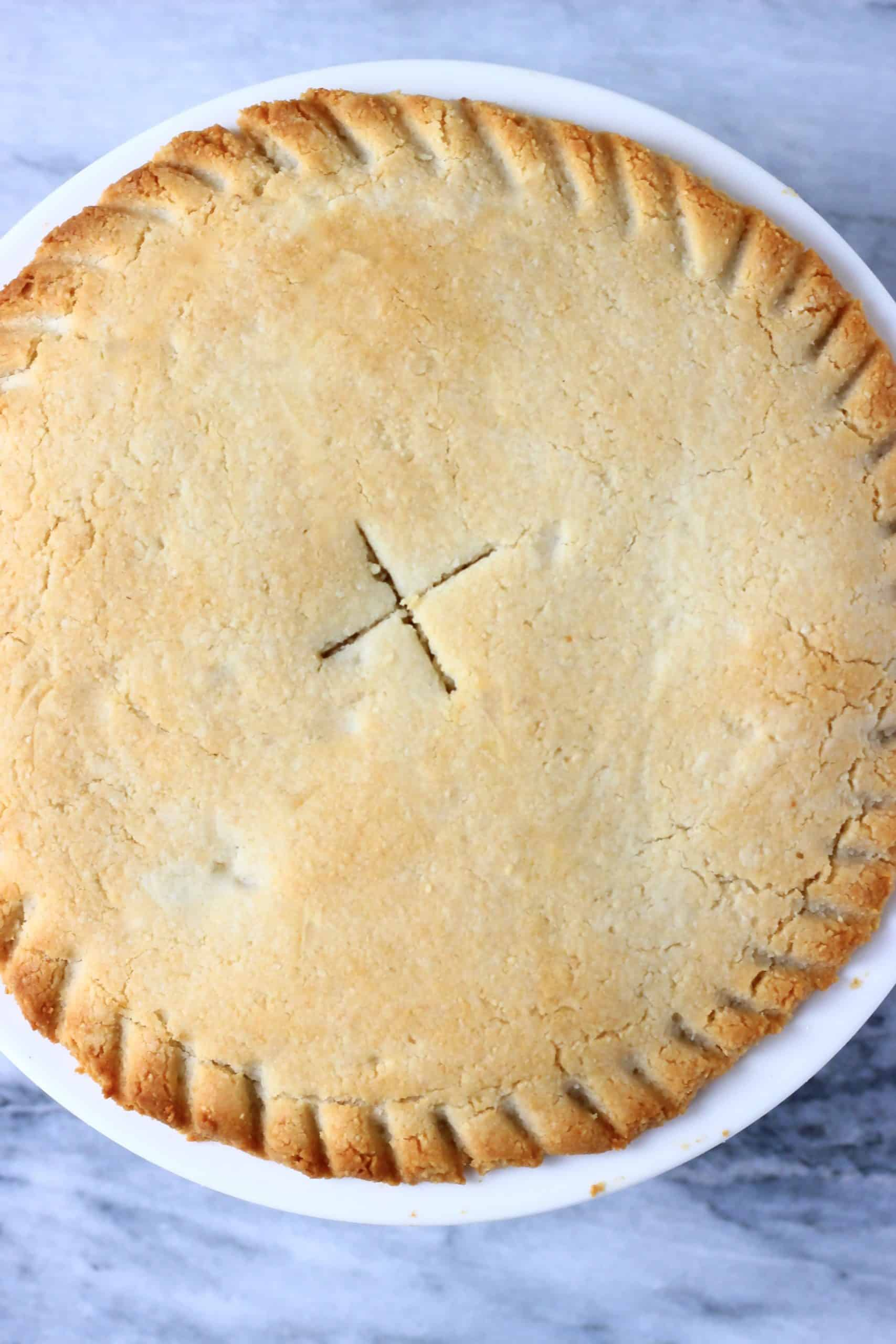 A gluten-free vegan apple pie in a pie dish