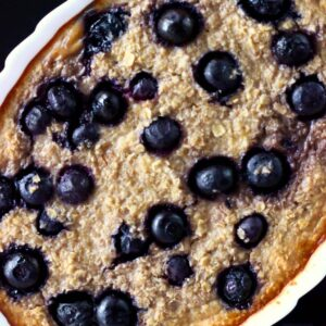 Vegan blueberry banana baked oatmeal in a white oval dish