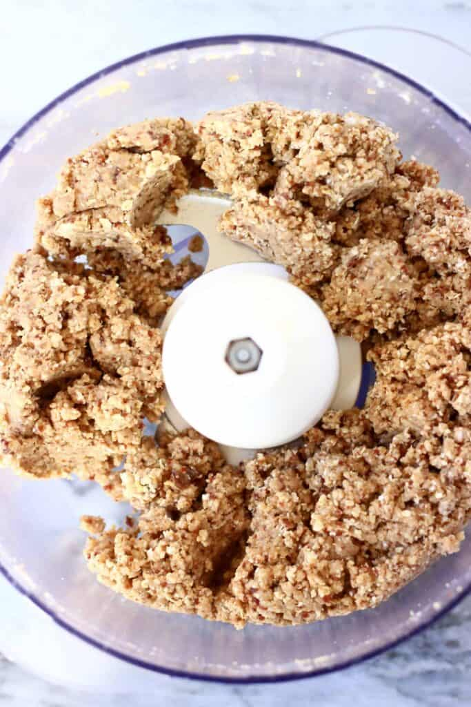 Photo of a food processor with brown crumble topping mixture