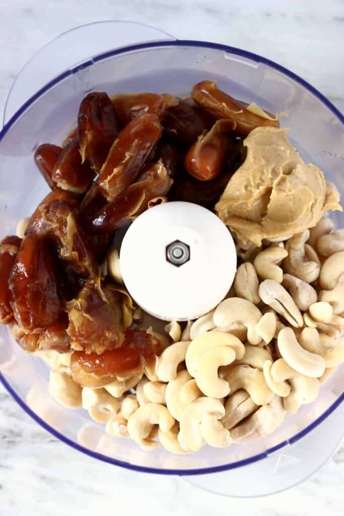Photo of cashew nuts, dates and almond butter in a food processor