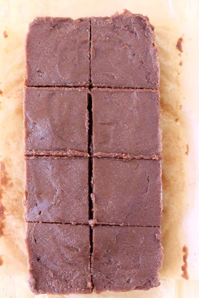 Photo of eight pieces of chocolate fudge on a piece of brown baking paper