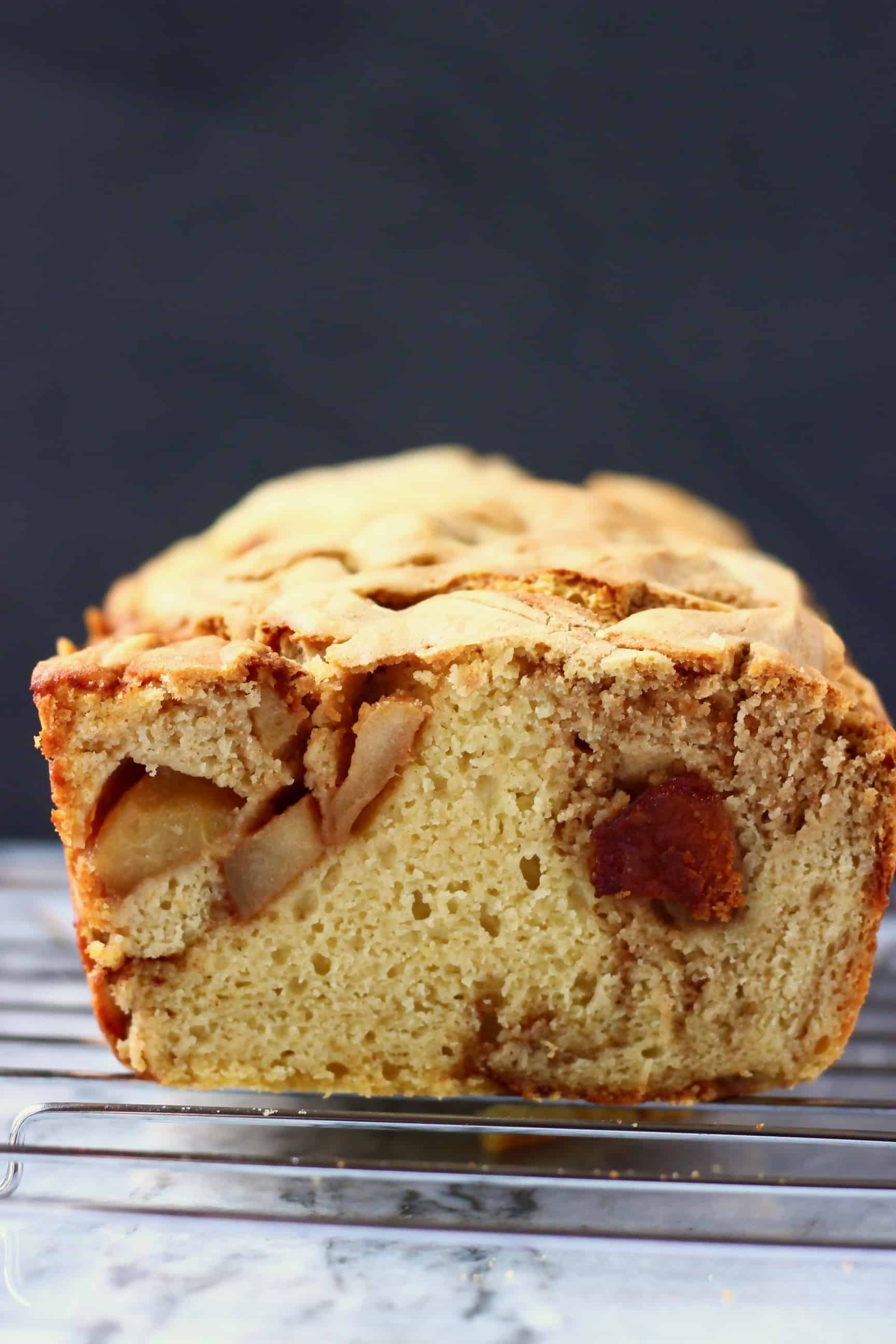 Sliced apple bread against a black background