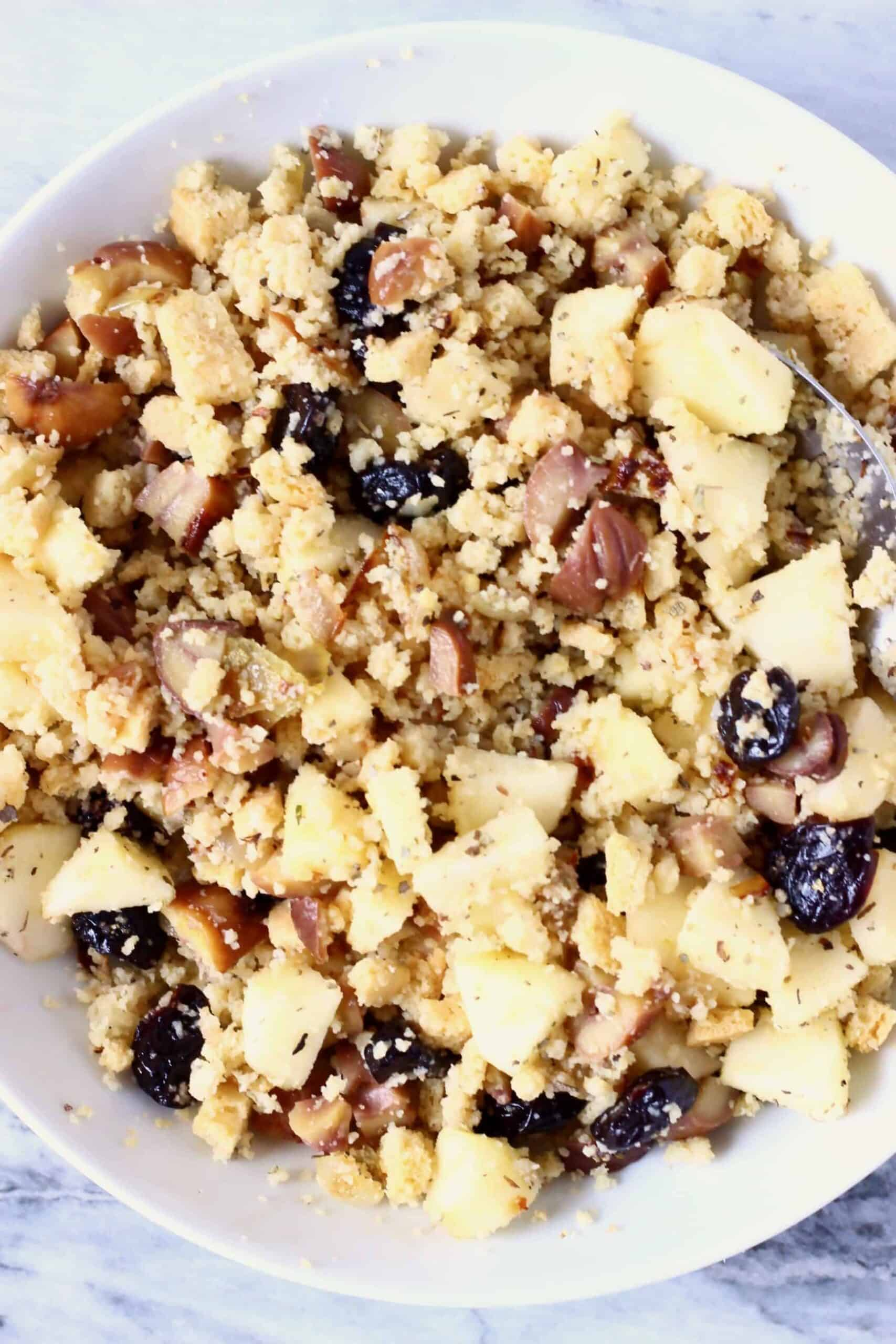 Diced apple, dried cherries, dried sage, chopped chestnuts, breadcrumbs and diced fried onion mixed together in a bowl