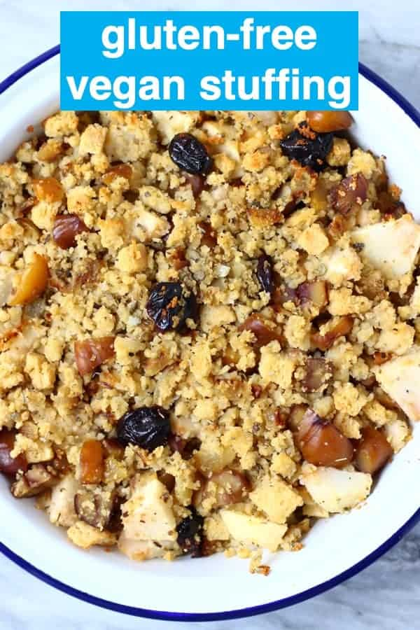 Photo of diced apple, dried cherries, dried sage, chopped chestnuts, breadcrumbs and diced fried onion mixed together in a white pie dish with a blue rim