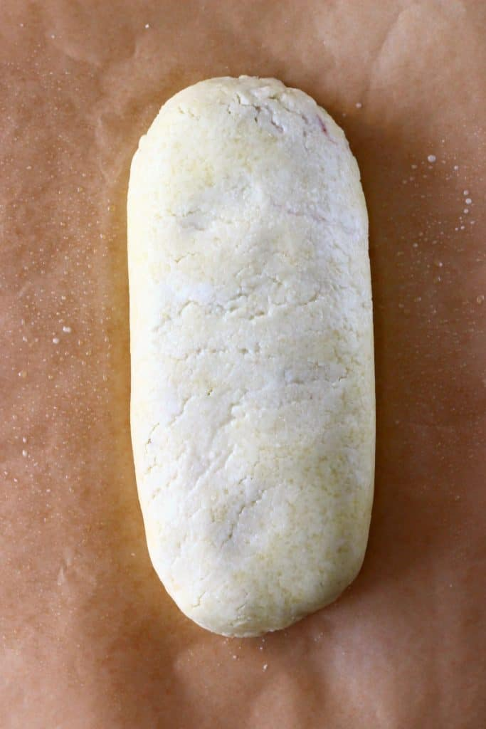 A raw wellington on a sheet of brown baking paper