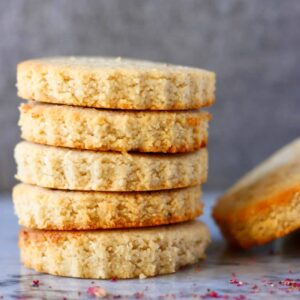 Five circular vegan shortbread cookies stacked up on each other